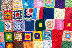 Colored knitted carpet textile background Royalty Free Stock Photos