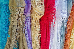 Colored lace scarves hanging Stock Images