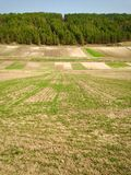 Colored land farming Stock Images