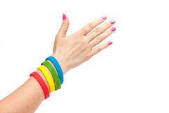 Colored latex bracelet on the arm Royalty Free Stock Photos