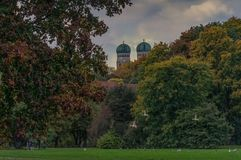 Colored leafes of trees in the bavarian capital of Munich. It`s fall time: Colored leafes of trees in the bavarian capital of Munich with flying ducks in the stock images
