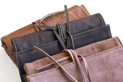 Colored leather clutch on ties Stock Photography