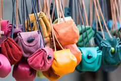 Colored leather moneybags hanging at laces Royalty Free Stock Image