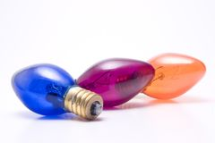 Colored Light Bulbs. Three colored light bulbs isolated on white Royalty Free Stock Photography