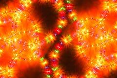 Colored light christmas garland illumination background, unfocused. Colored light christmas garland illumination. Christmas or other holiday decorations Stock Photography