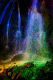 Colored Light Painted Waterfall Stock Image