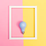 Colored lightbulb on a duotone background Royalty Free Stock Image