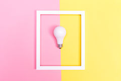 Colored lightbulb on a duotone background Stock Image
