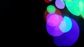 Colored lights bokeh on black stock video