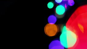 Colored lights bokeh on black stock video footage