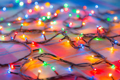 Colored lights Christmas garlands. Colorful abstract background.  Royalty Free Stock Image