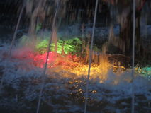Colored lights in the fountain by night Stock Photography