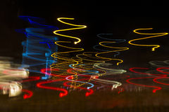 Colored lights in motion of spiral at night as abstract backgrou Royalty Free Stock Image