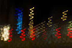 Colored lights in motion of spiral at night as abstract backgrou Stock Images
