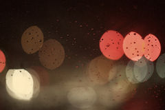Colored lights on a rainy night Royalty Free Stock Image