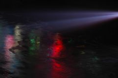 Colored lights reflected on water. A picture of the surface of Niagara River, below the famous waterfalls at night. Reflections of various colored lights can be Stock Photos
