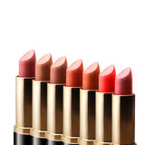 Colored lipstick standing in a row on white background Stock Photos