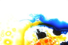 Colorful liquids mixed together to an abstract painting. Colored liquids mixed together in fluid creating colorful abstract painting consisting of gradients and royalty free stock images