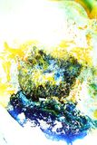 Colorful liquids mixed together to an abstract painting. Colored liquids mixed together in fluid creating colorful abstract painting consisting of gradients and royalty free stock photo