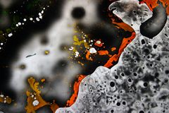 Colorful liquids mixed together to an abstract painting. Colored liquids mixed together in fluid creating colorful abstract painting consisting of gradients and stock image