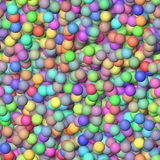 Colored little balls randomly scattered on the seamless background - top view Stock Image