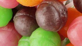 Colored Lollipop with fruit. Colored Lollipop with bio fruit stock video footage