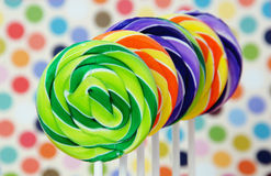 Colored lollipops. Colorful swirled lollipops on a party background Stock Photography