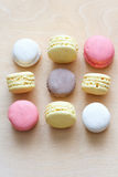 Colored macaron on wooden background Royalty Free Stock Images