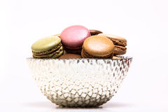 Colored macarons inside bowl Stock Photos