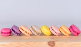 Colored macaroon closeup on a wooden surface Stock Image