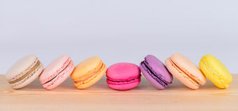 Colored macaroon closeup on a wooden surface Stock Photo