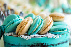 Colored macaroon on gift box Royalty Free Stock Photography