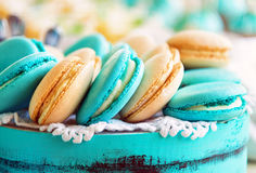 Colored macaroon on gift box. Photo toned style Stock Image