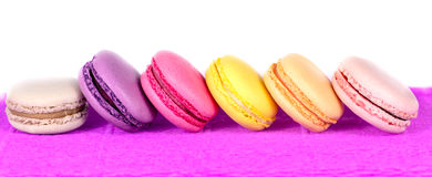 Colored macaroon on a purple background Royalty Free Stock Photography