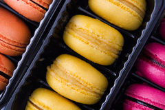 Colored macaroons background. Some sweet colored macaroons background Royalty Free Stock Image