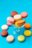 Colored macaroons. On a blue Background Royalty Free Stock Photos