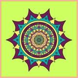 Colored mandala on light green background Stock Photography