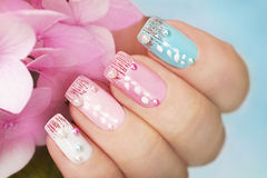 Colored manicure with hydrangea. Stock Image