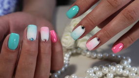 Colored manicure nail design. Manicure Stock Images