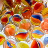 Colored Marbles. In a flat layer Stock Images