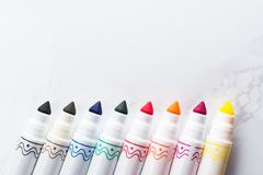 Colored Markers Arranged In A Row On A Marble Table stock photography