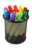 Colored markers in basket on the white background stock photography