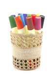 Colored markers in basket on the white background Stock Photos
