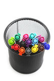 Colored markers in basket on the white background Royalty Free Stock Photo