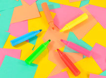 Colored markers on the colored cards background. Stock Image