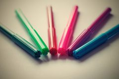 Colored markers with lids Royalty Free Stock Photo