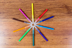 Colored markers lined in the form of sunlight. Highlighting. Art paint. Stationery. Stock Photos
