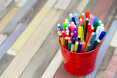 Colored markers in a metal bucket. Royalty Free Stock Images