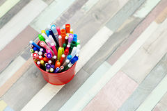 Colored markers in a metal bucket. Stock Photography