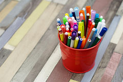 Colored markers in a metal bucket. Royalty Free Stock Photography
